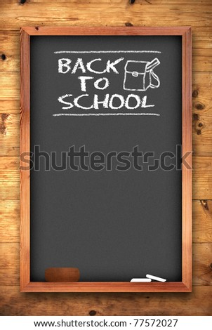 back to school chalkboard on wooden wall - stock photo