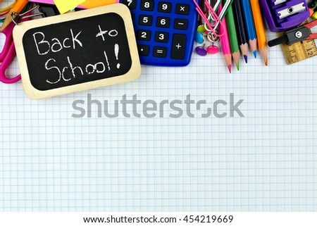 Back to School chalkboard tag with school supplies top border on graphing paper background - stock photo