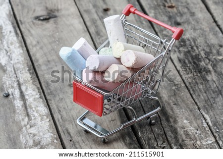 back to school - close up of red chrome shopping cart - stock photo