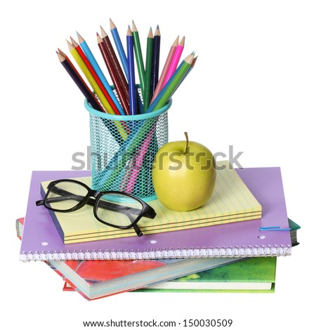 Back to school concept. An apple, colored pencils and glasses on pile of books isolated on white background