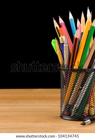 back to school concept and office supplies isolated on black background - stock photo