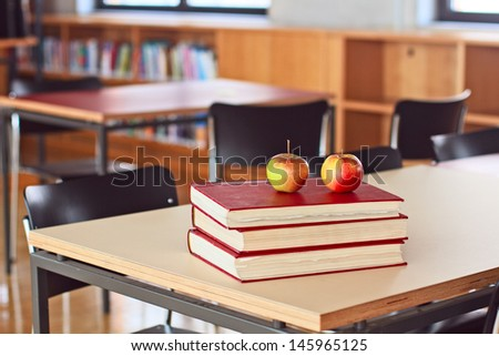 Back to school concept, apples over books - stock photo