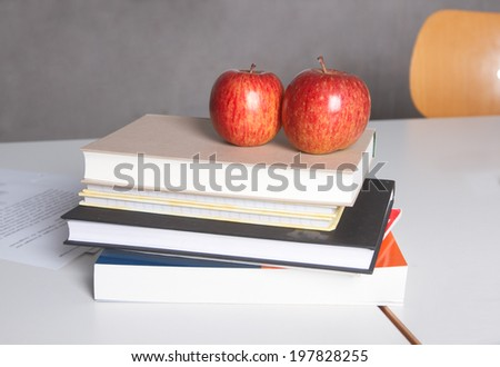 Back to school concept, apples over books