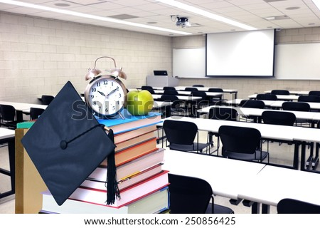 back to school concept: book stack and class room - stock photo