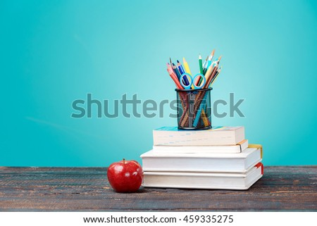 Back to School concept. Books, colored pencils and apple - stock photo