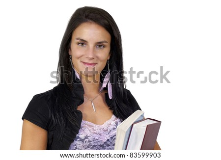 Back to school concept: Friendly smiling young dark haired woman, teacher or student, holding reference books, isolated on white background.
