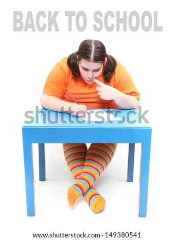 Back to school concept. Frustrated obese student. - stock photo