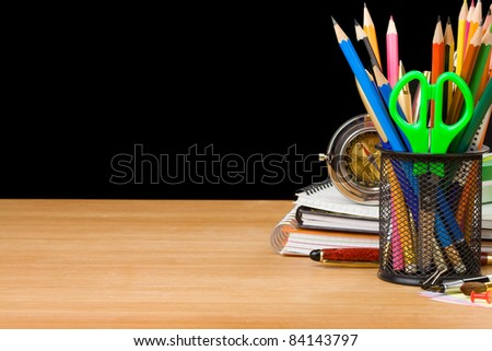back to school concept isolated on black background - stock photo
