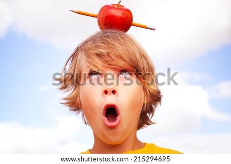 Back to school concept, pencil shooting through an apple. - stock photo