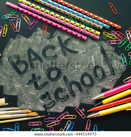 Back to school concept. School supplies on blackboard background. Back to school concept with stationery. Schoolchild and student studies accessories. Top view. Square. - stock photo