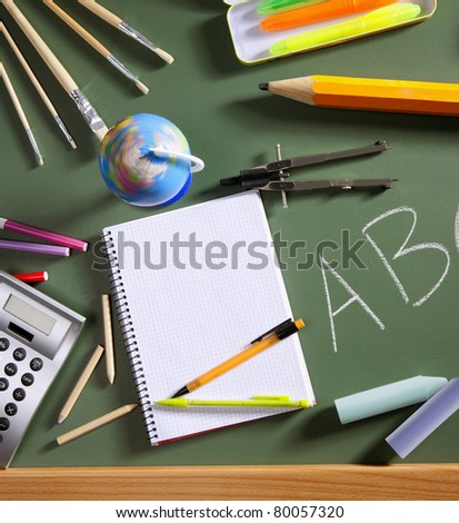 back to school concept with ABC written in school in green color blackboard - stock photo
