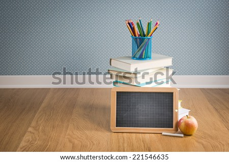 Back to school concept with blackboard, colorful stationery and apple. - stock photo