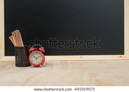 Back to school concept with clock andequipment - stock photo