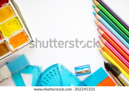 Back to School concept with colourful pencils, brushes, rulers, paints and stickers - stock photo
