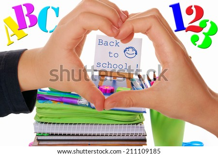 back to school concept with heart shaped kids hands and school staffs - stock photo