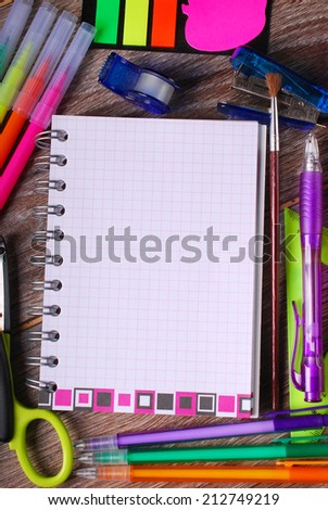 back to school concept with school staffs and note with space for own text on wooden background  - stock photo