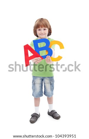 Back to school concept with young child holding large alphabet letters - isolated - stock photo
