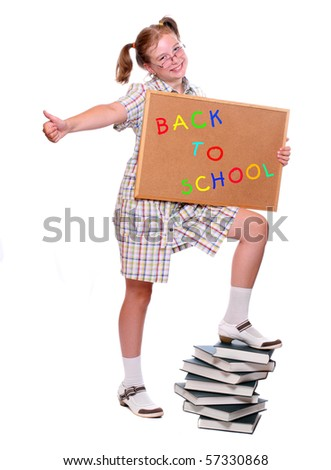 Back to School. Cute girl with cork board on white background. Conceptual image. - stock photo