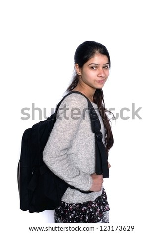 Back to school: Cute Indian student smiling with backpack, over isolated white background. - stock photo