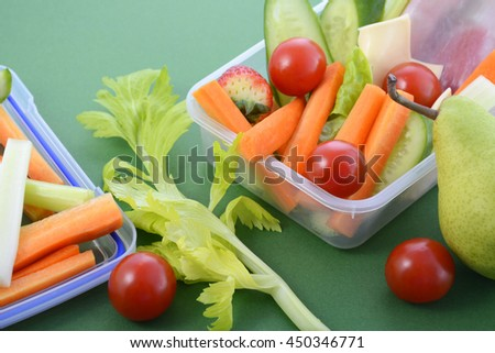 Back to school healthy school lunch box on green background, closeup.  - stock photo