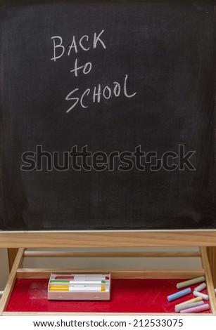 Back to school in black board - stock photo