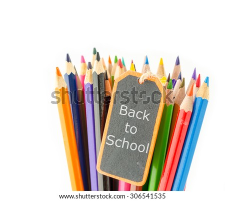 Back to school in black wooden tag and Colorful pencil crayons on a white background, Back to school - stock photo