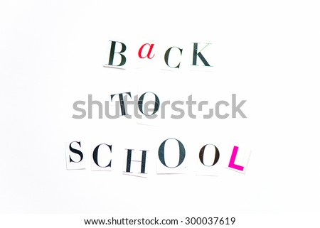 Back to School Letters cut out from the Magazine on White Background - stock photo