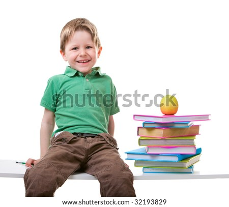 Back To School. Little boy with books isolated on white background - stock photo