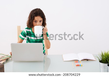 Back to School. Little girl using laptop - stock photo
