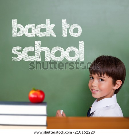 Back to school message against cute pupil holding chalk - stock photo