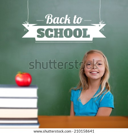 Back to school message against cute pupil smiling