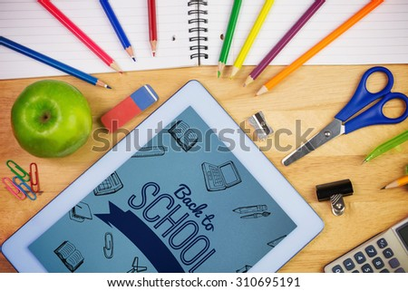Back to school message with icons against students table with school supplies - stock photo