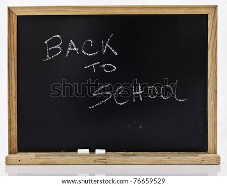 Back to school on blackboard in white background - stock photo