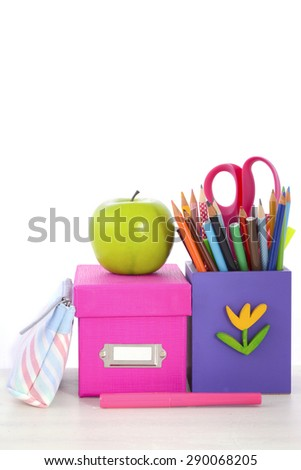 Back to School or Education Concept with classroom desk and bright colored stationery supplies on white wood rustic table.  - stock photo