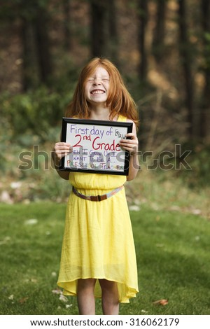 Back to school picture. First day of Second grade.  - stock photo
