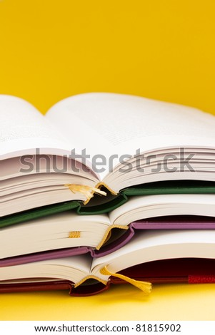 back to school - pile of books - stock photo