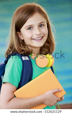 Back to school -  portrait of beautiful young schoolgirl - stock photo