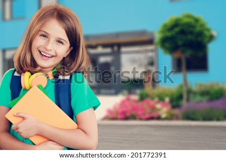 Back to school - portrait of beautiful young schoolgirl, education concept