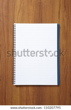 Back to School pupils note pad on wooden school desk from above - stock photo