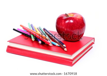 back to school - red apple and colored pencil on red books (isolated on white background) - stock photo