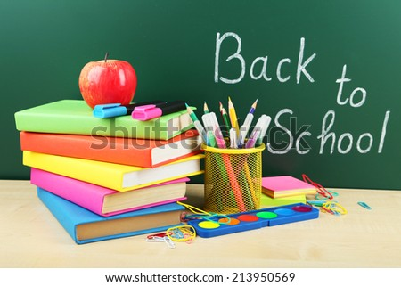Back to school. School supplies.Books and blackboard.