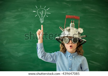 Back to school. Schoolchild with virtual reality headset. Child in class. Funny kid against blackboard. Nerd kid having fun. Geek child with VR glasses. Innovation technology and education concept - stock photo