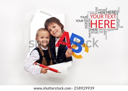 Back to school season opening - two happy kids with school items - stock photo