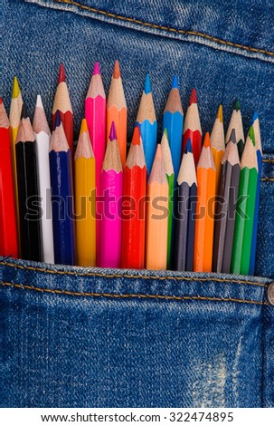 back to school set of multicolored pencils in blue jeans pocket - stock photo
