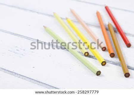 Back to School. Some colored pencils on a white wooden table. Vintage Style. - stock photo