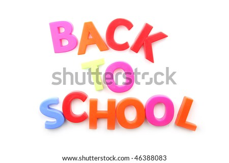 Back to School spelled out using fridge magnets on a white background