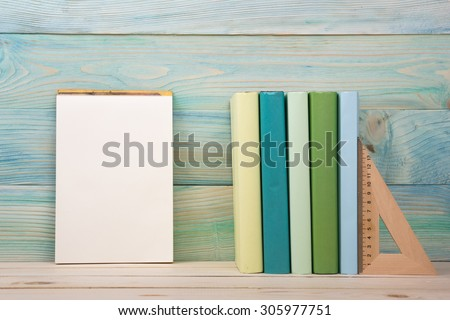 Back to school. Stack of colorful books on wooden table. Composition with vintage old hardback books, diary on wooden deck table. Books stacking. Copy Space. Education background.  - stock photo