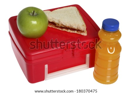 Back to School still life with apple, sandwich, juice, and red lunchbox on white  - stock photo