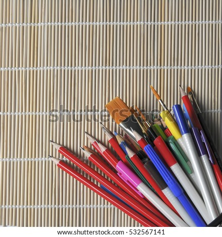 Back to school supplies on a bamboo mat