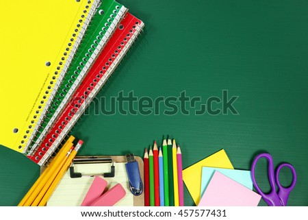 Back to School Supplies on Blank Chalkboard